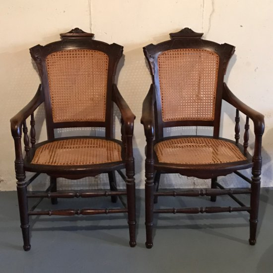 Pair of Antique Ornately Carved Walnut Cane Bottom Captains Chairs