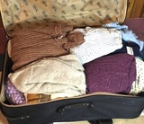 Suitcase Full of Vintage Sweaters