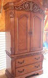 Beautiful 2 Piece Oak Finish Armoire with Metal Detail, 2 Drawers on Bottom and Shelf for Clothes