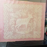 Antique Lace Deer Scarf Under Glass on Pink Fabric Background