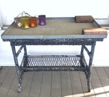Wicker Patio Table With Galvanized Tray On Top, and Glass Candle Holders