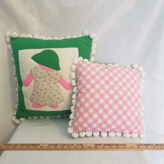 Lot 2 Accent Pillows – 1 Appliqued Doll & 1 Pink & White Checkered – both w/ Pom Pom Fringe
