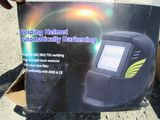 NEW & UNUSED AUTO DARKENING WELDING HELMET