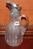 Water pitcher with silver rim