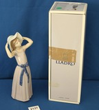 Lladro Trying on a Straw Hat