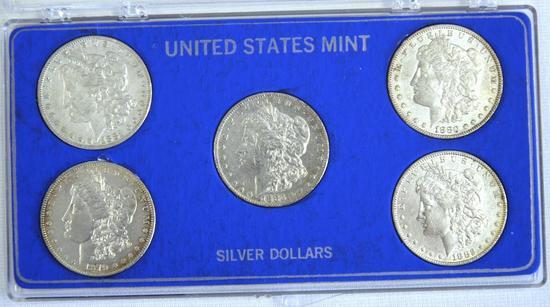 (5) Morgan Dollars in Plastic Case 1879, 1880, 1881, 1882, 1883