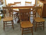 Round Oak Dining Table with 3 Leaves and 8 Chairs