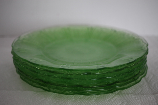 "Set of 9 Green Depression Glass Plates, Cherry Blossoms, Jeanette, 7"" round, 1 plate has a mark"