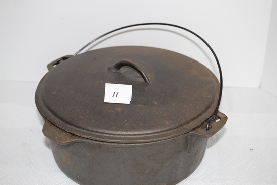 "Cast Iron Dutch Oven, Made In Taiwan, 12"" round at top"