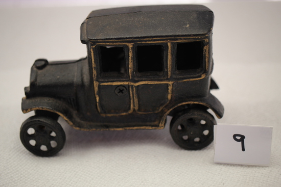 "Cast Iron Car, 5 1/2"" x 3 1/2""H, One wheel comes off"