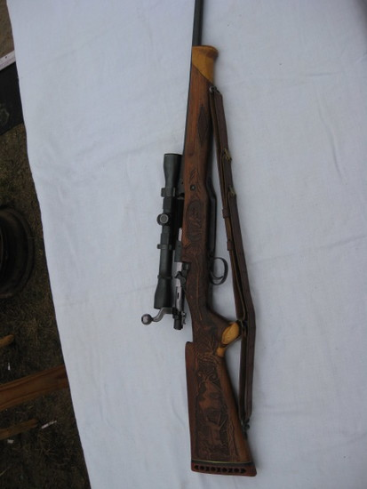Wincherster model of 1917 bolt action rifle with Weatherby scope