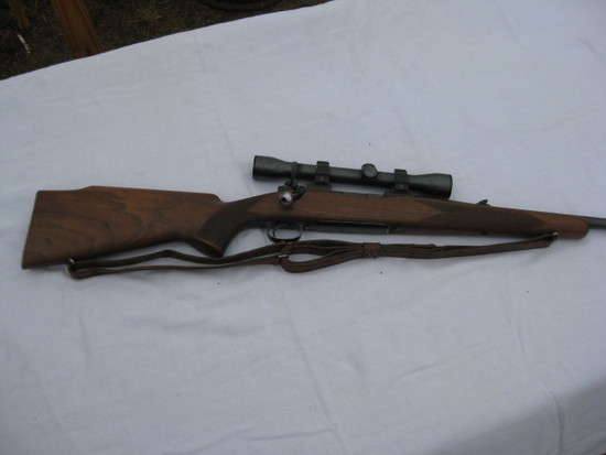 Wincherster model 70 bolt action rifle with Weatherby scope