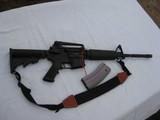 Bushmaster model X7-15E2S s Auto rifle and clip