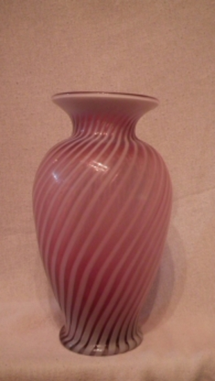 "Cranberry opalescent vase, spiral optic pattern, stamped Fenton, late 1980s, 13""H x 5.5""W"
