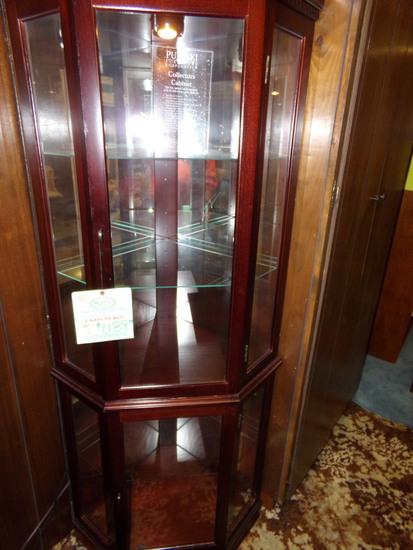 by Pulaski Corner Curio Cabinet