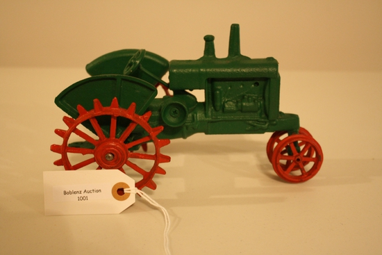 Green cast iron tractor red wheels/metal