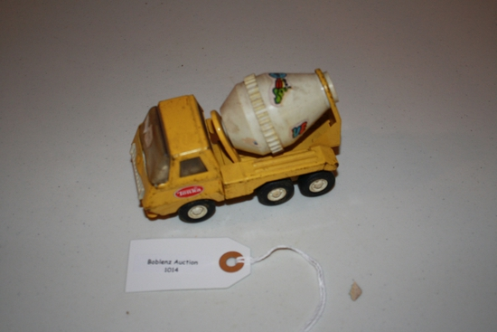 small yellow cement mixer truck