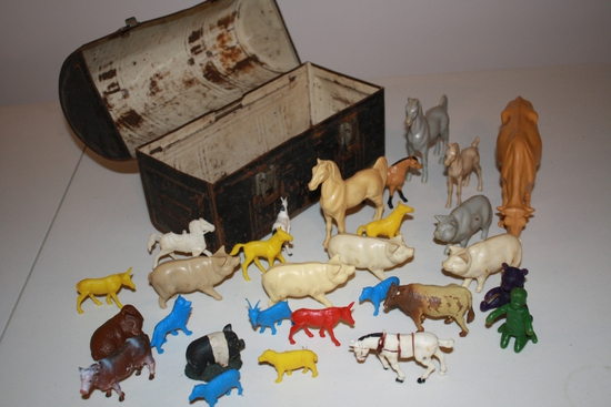 antique lunch box with plastic farm animals