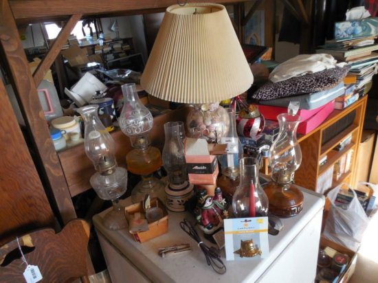 Contents of Top of Freezer Including Old Lamps