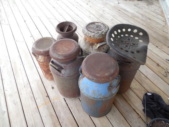 Six Antique Milk Cans Plus Tractor Seat Top