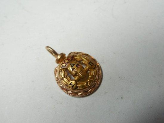 Early 10k Gold Fraternal Skull Pendant