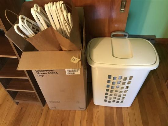 Hamper and box of clothes hangers