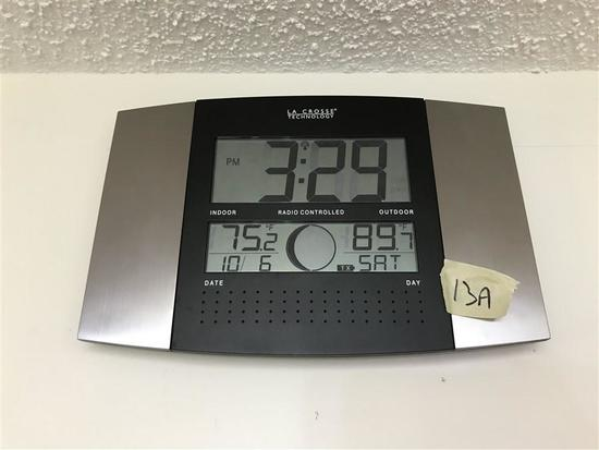 Clock with indoor outdoor temperature