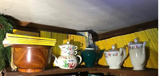 Shelf Lot Ceramics and National Geo magazines