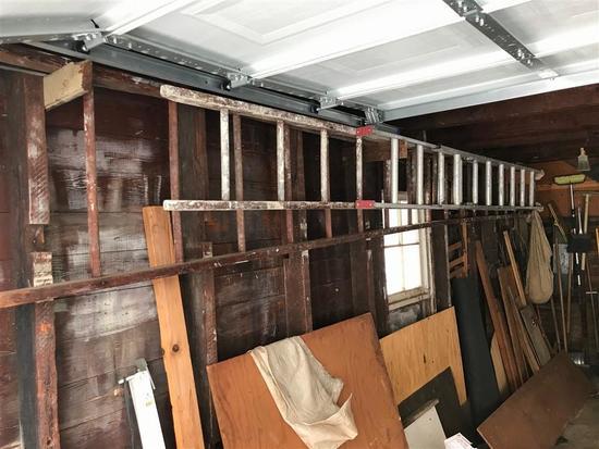 2 Extension ladders - 36' Wood, 18' Aluminum