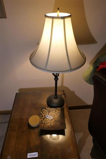Lamp and items on table