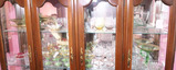 Top two shelves of antique glass in cabinet