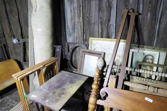 Lot of Framed, Artwork, Bottles Along Barn Wall