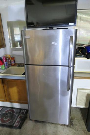 Stainless Steel Refrigerator in Garage Frigidaire