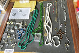 Group lot assorted costume jewelry.