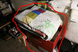 Stack of quilts, blankets in box