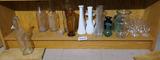 Shelf lot of antique bottles