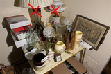 Antiques, collectibles on card table