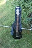 Black Electric Guitar by House of Blues
