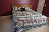 King Sized Bed w/wooden headboard