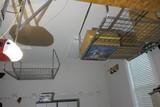 Two Ceiling Mounted Metal Storage Racks