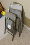 Four padded folding chairs