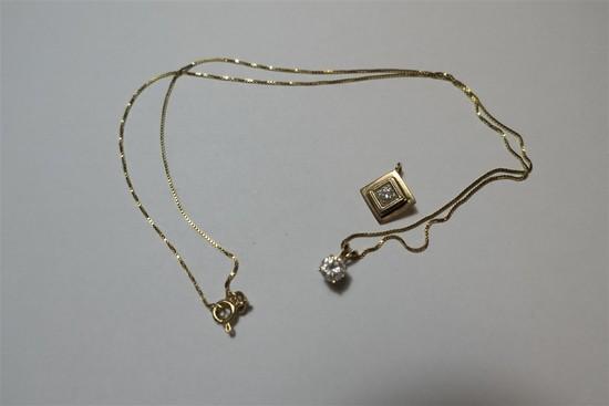 2 14k pendants set with diamonds