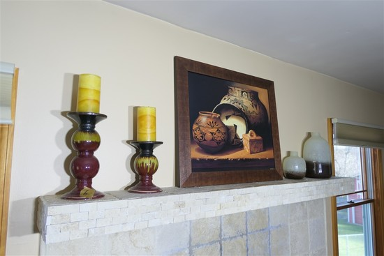 Candles, stands, art, ceramics etc on mantle