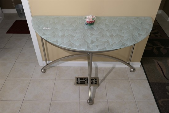 Floral pattern glass topped demi-lune table