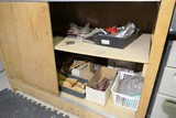 Assorted cabinet contents - mostly sanding