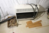 Gas heater and scrap wood