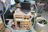 Chisels, small wood tools, desk, monitor, printer