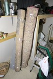 3 Rolled up carpets