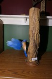 Carved wood and painted blue bird by Emeric Zuccaro