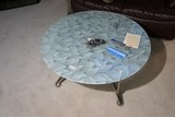 Glass topped leaf pattern coffee table